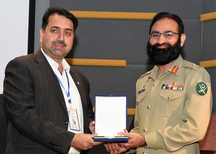 Mr. Samee ur Rahman Managing Director WISH Receiving Speaker Award at Air University Islamabad